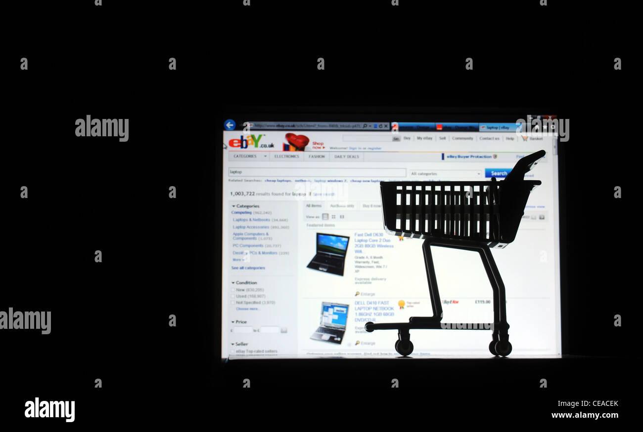 Pantalla de ordenador con carrito de la compra Volver