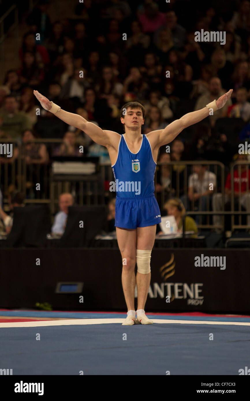 Mykola Kuksenkov (UKR) compite en el ejercicio del piso en el caso de la copa Americana 2012 Gimnasia Imagen De Stock