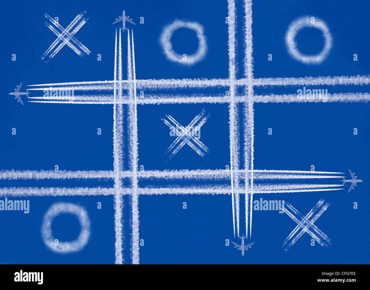 Cuatro aviones jugando en el cielo Imagen De Stock