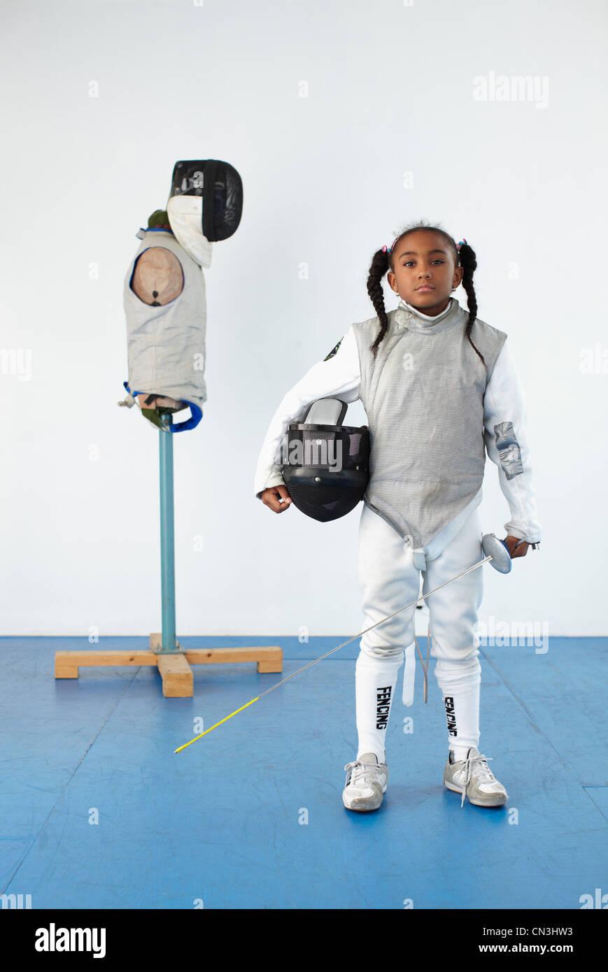Retrato de niña en de esgrima Imagen De Stock