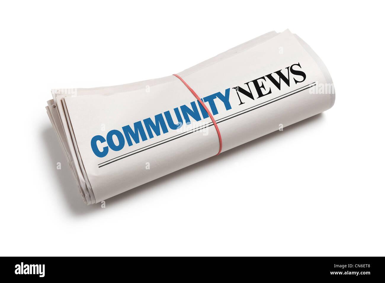 Comunidad Noticias, periódico rollo con fondo blanco. Imagen De Stock