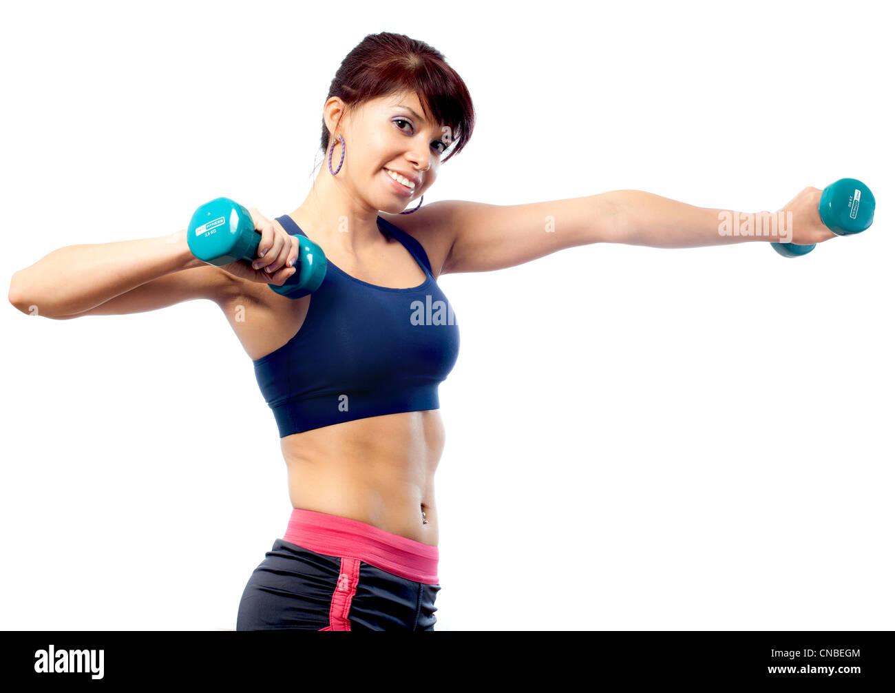 Entrenador de fitness femenino con pesas Imagen De Stock