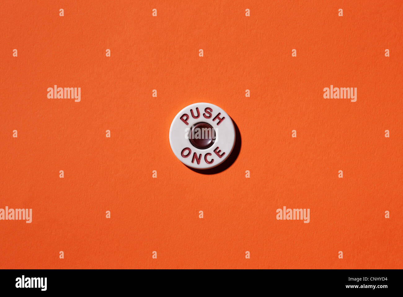 Pulse una vez el botón de fondo naranja Imagen De Stock