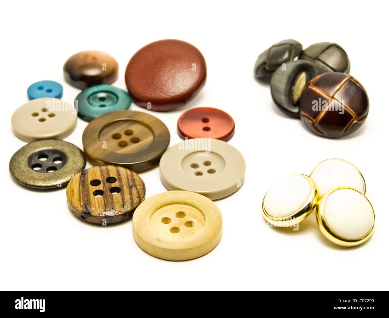 Coser botones Foto de stock