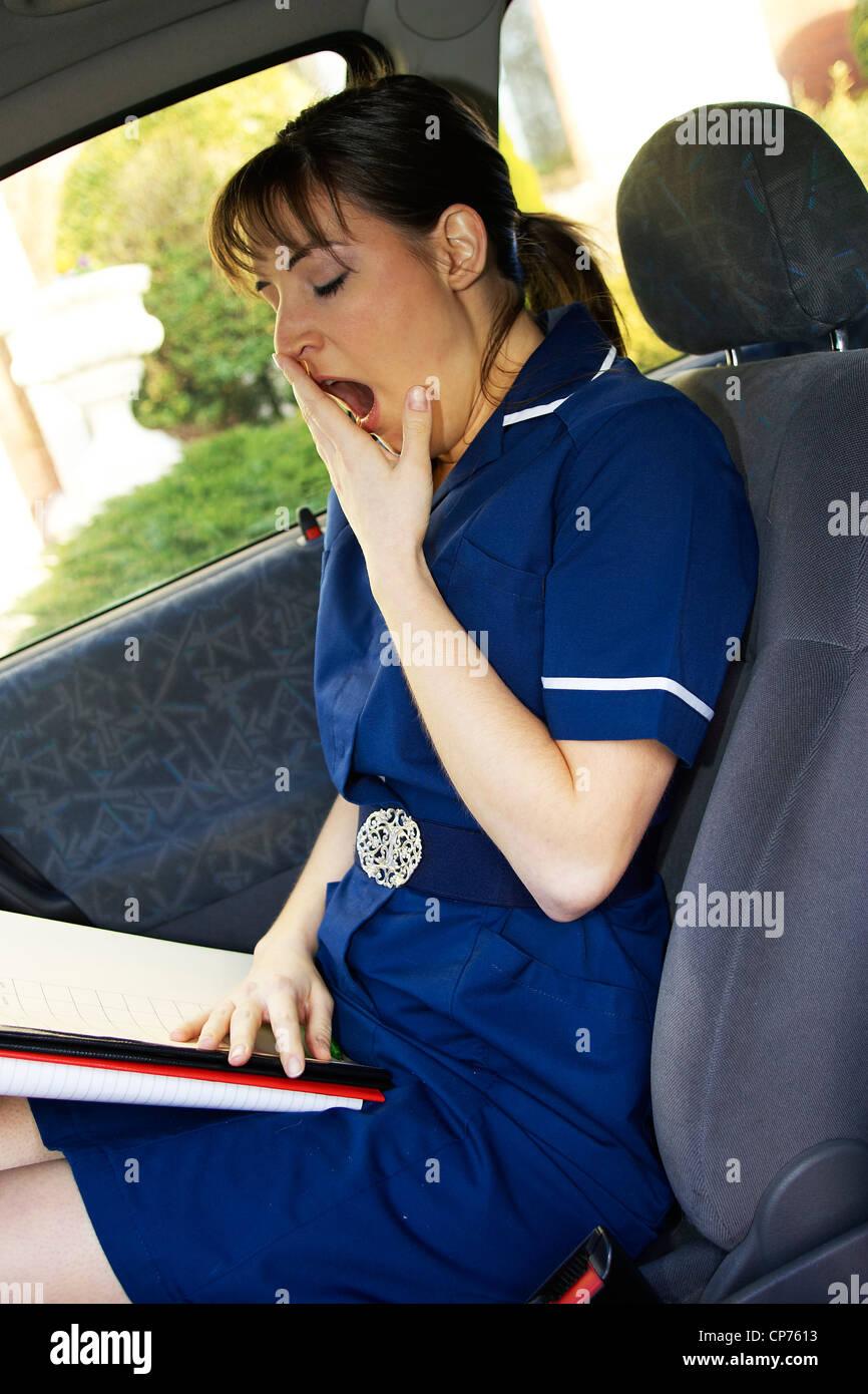 Enfermeras del distrito sat en coche Imagen De Stock