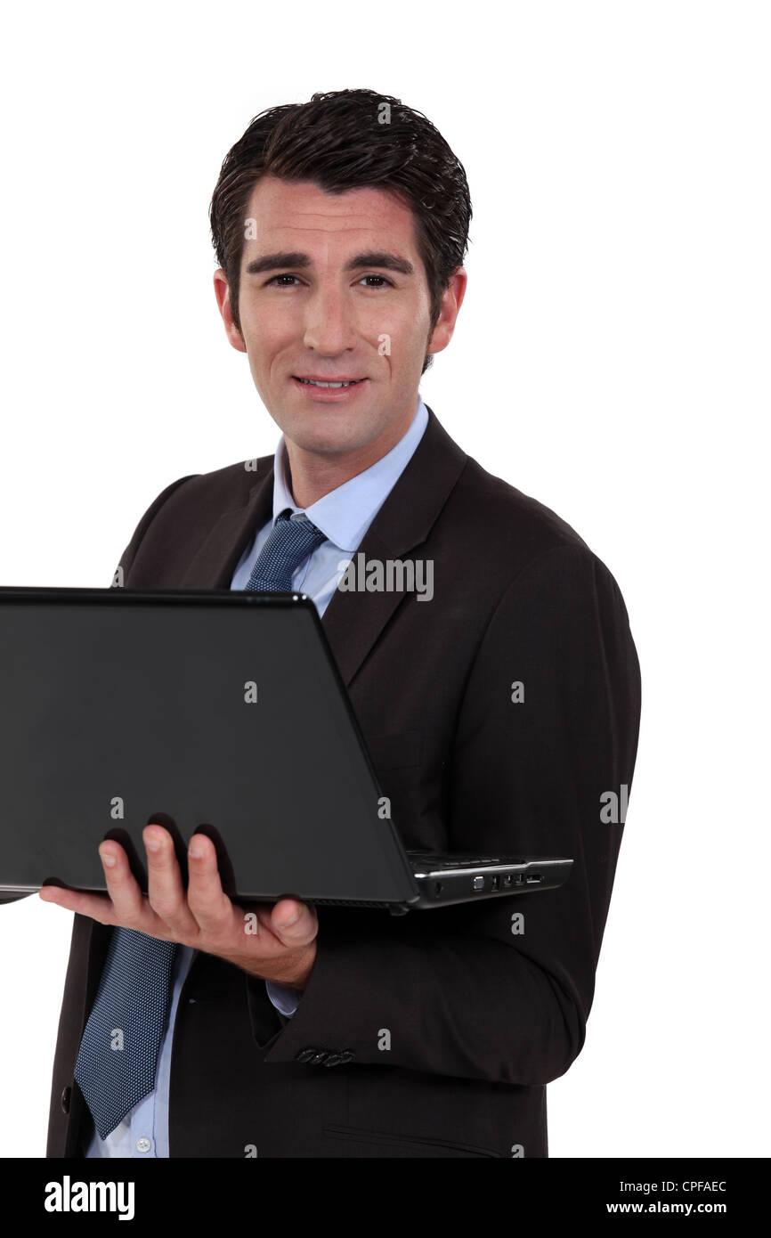 Ejecutivo con ordenador de mano Imagen De Stock