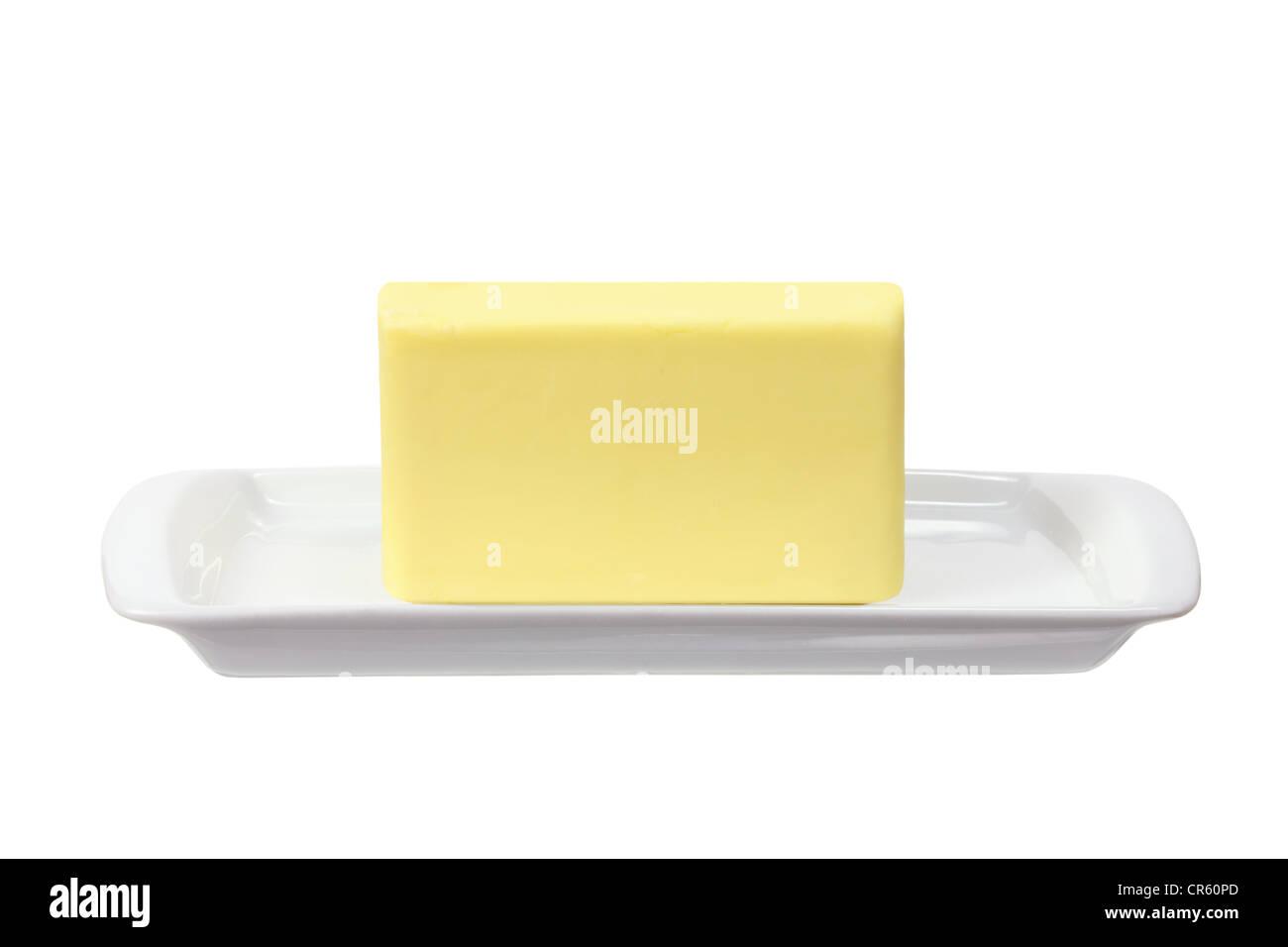 Mantequilla en placa Imagen De Stock