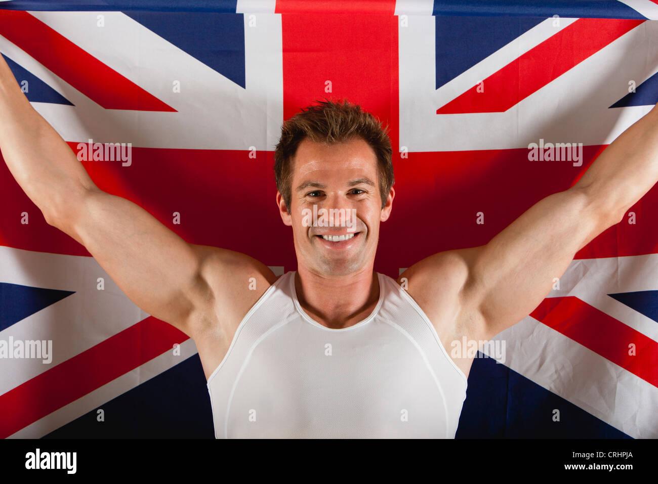 Atleta Masculino en frente de la bandera británica Imagen De Stock