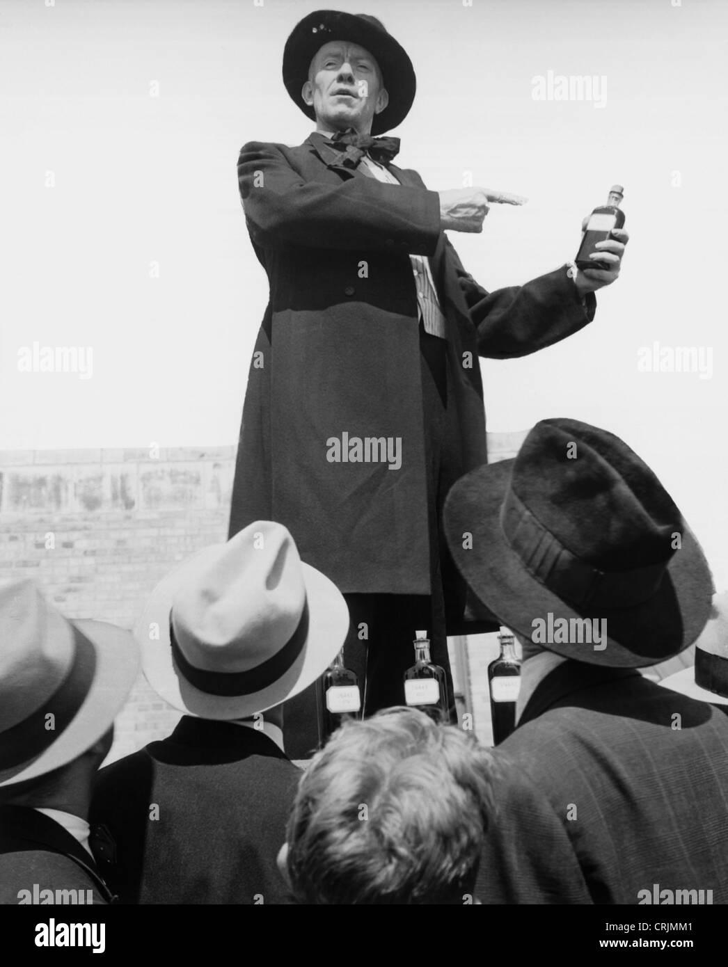 Los testigos de Jehová: organizados para predicar las buenas nuevas El-vendedor-vende-elixir-en-botella-para-multitud-crjmm1