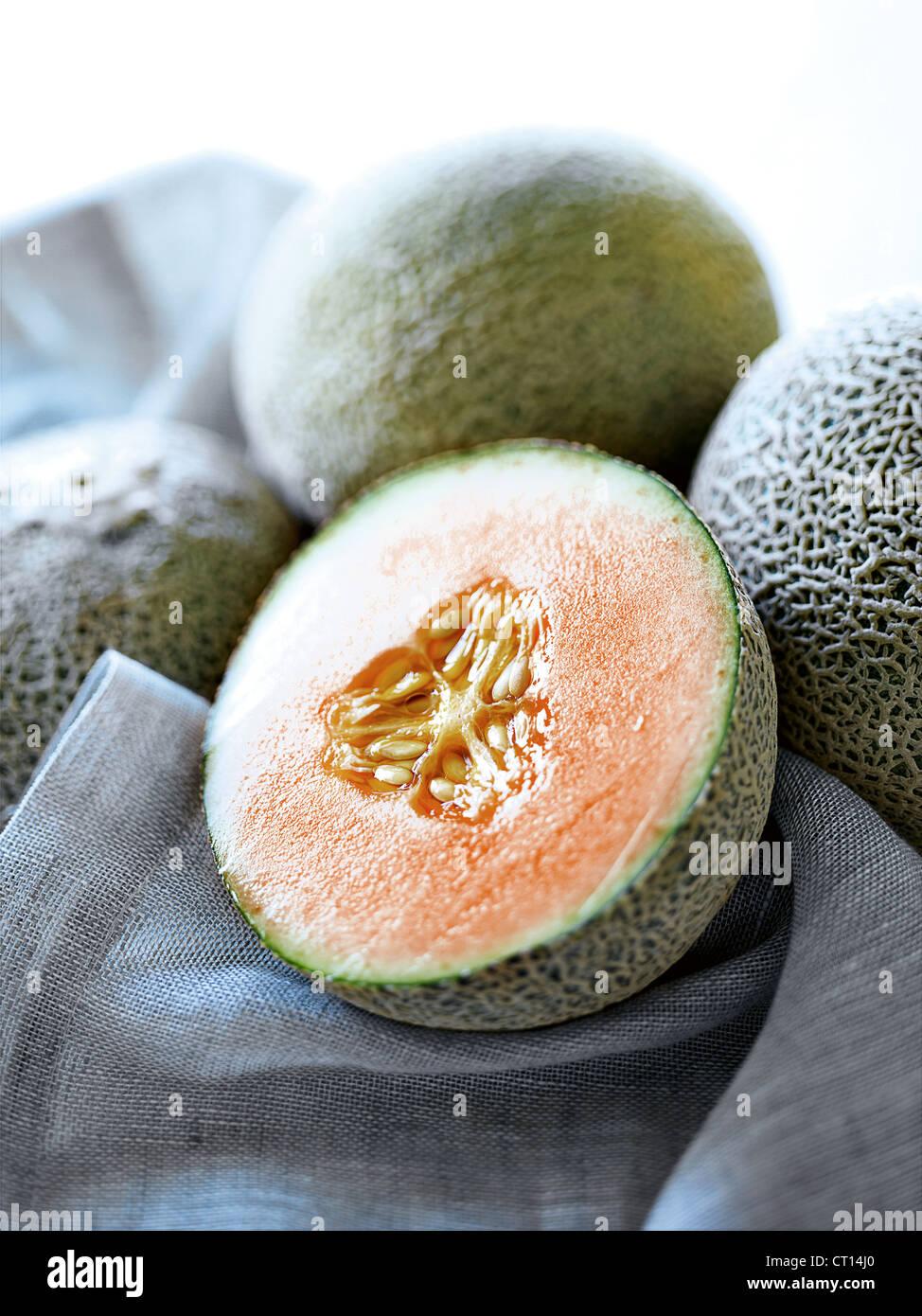 Cerca de la mitad de melón Imagen De Stock