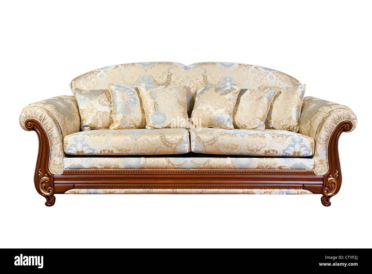 Sofá con almohadas aislado en blanco Imagen De Stock