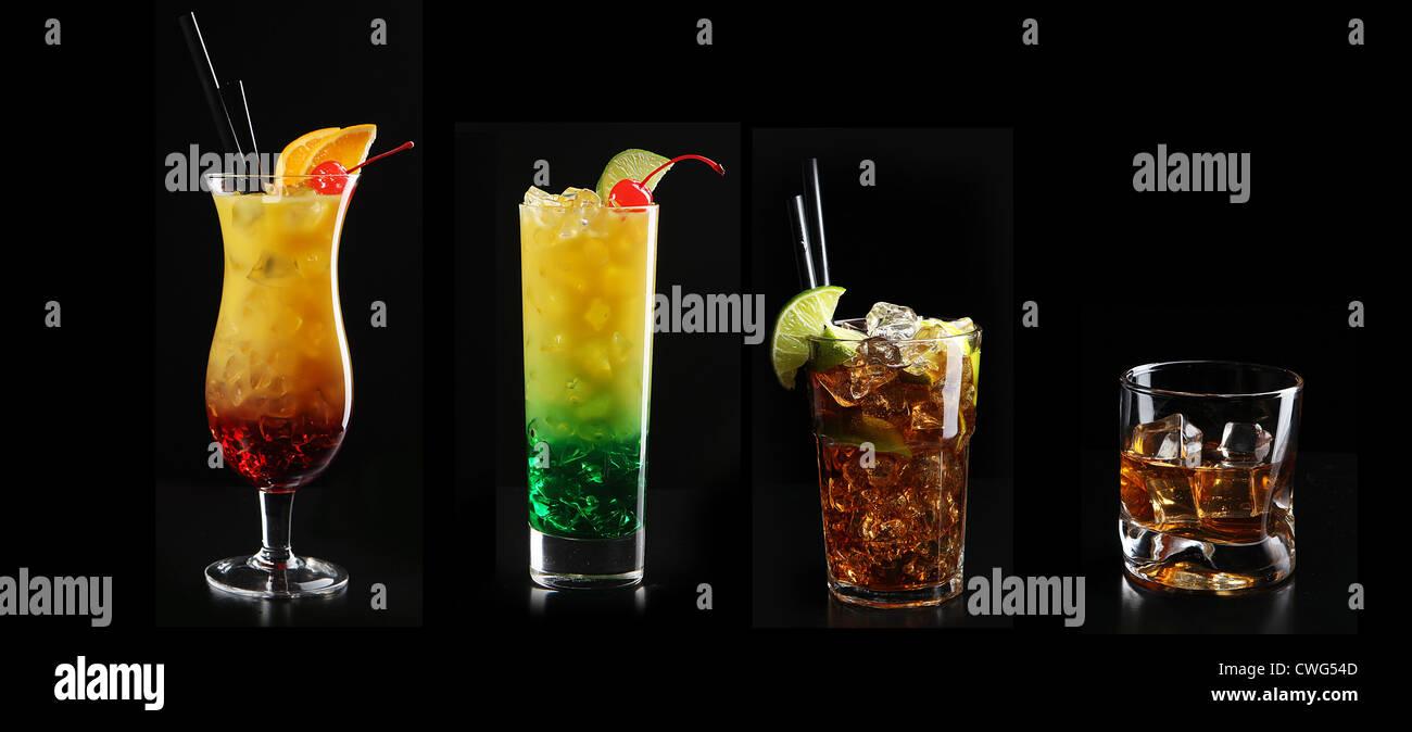 Set con diferentes cócteles sobre fondo negro Foto de stock
