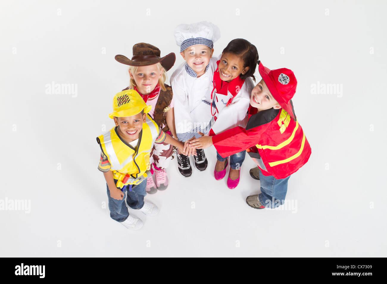 Vista aérea de niños en uniformes profesionales trabajo en equipo Imagen De Stock