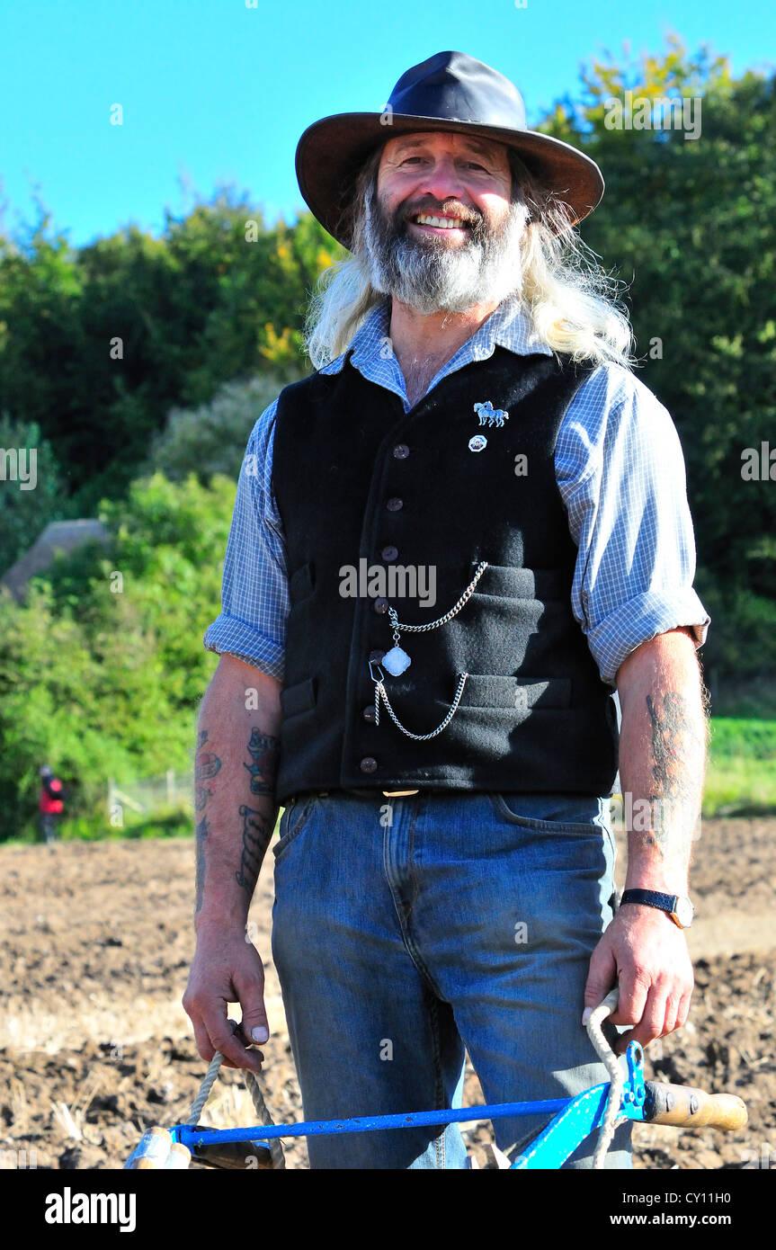 """Retrato de Geoff Amor',Propietario y plowman del multi-ganador del premio """"Ben"""" ,un negro Dales Shire Imagen De Stock"""