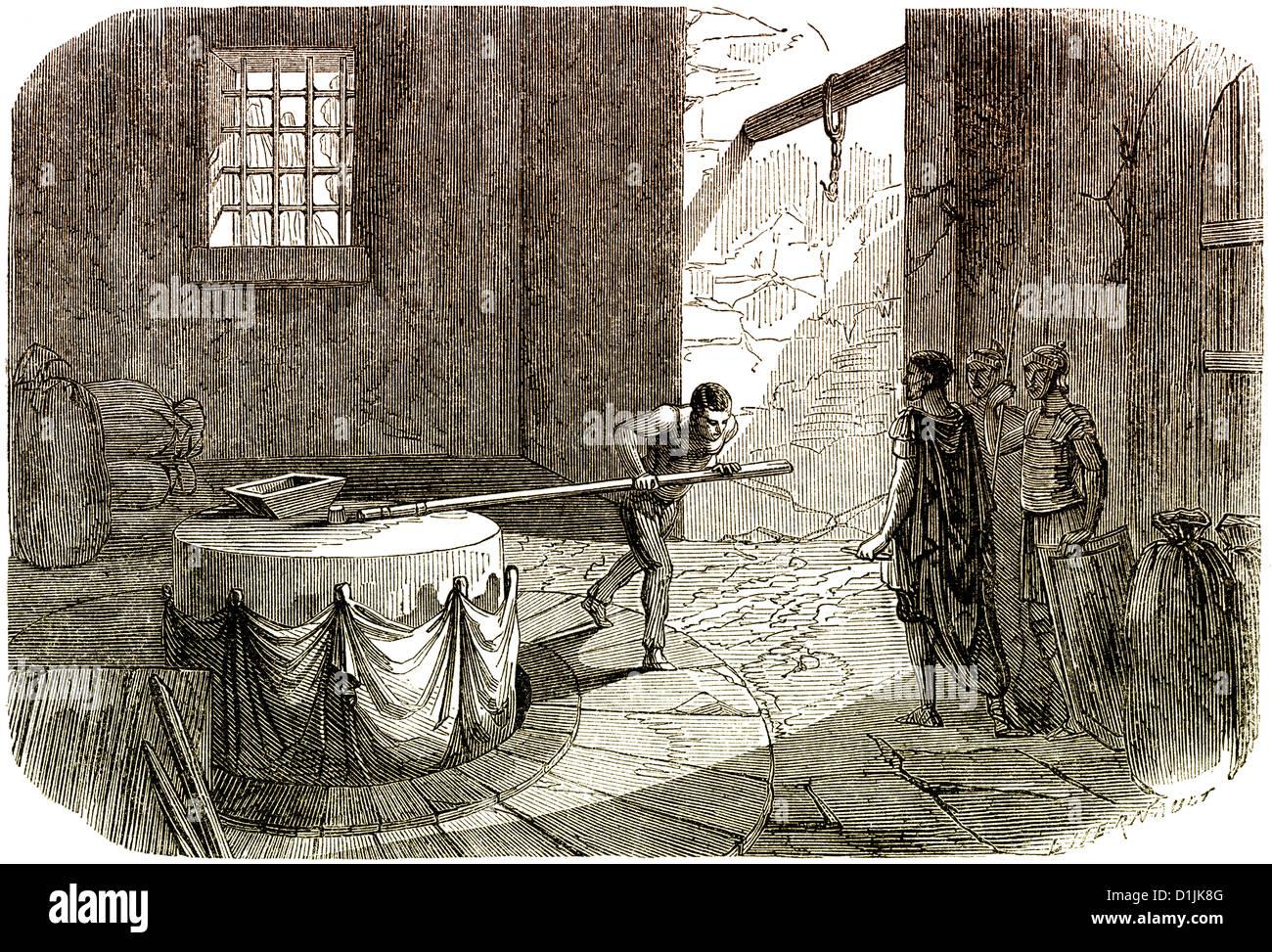 Las escenas de la historia de Francia, un hombre girando la rueda de un molino de la civilización galorromana Imagen De Stock