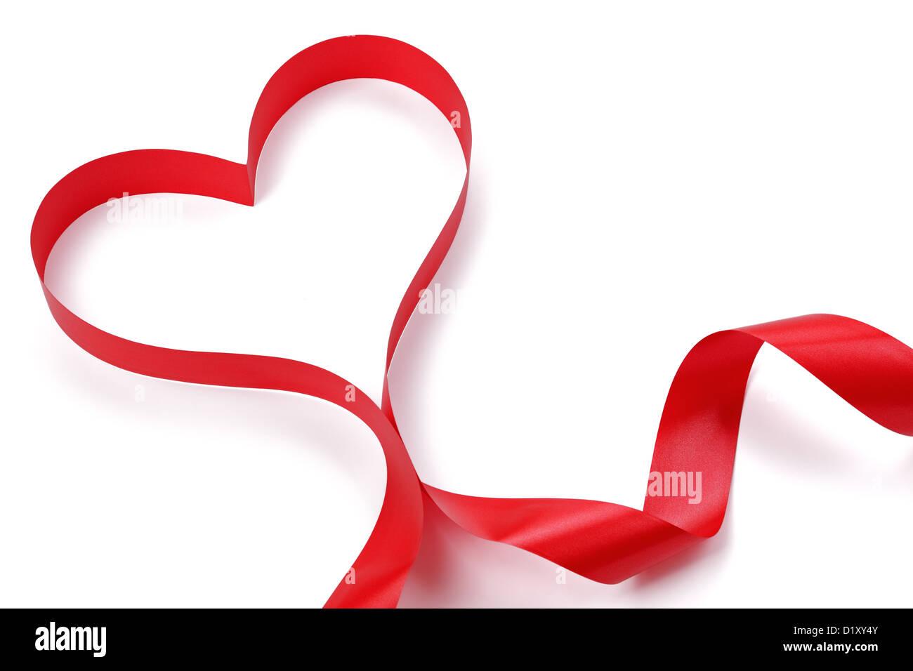 La cinta roja con forma de corazón Foto de stock