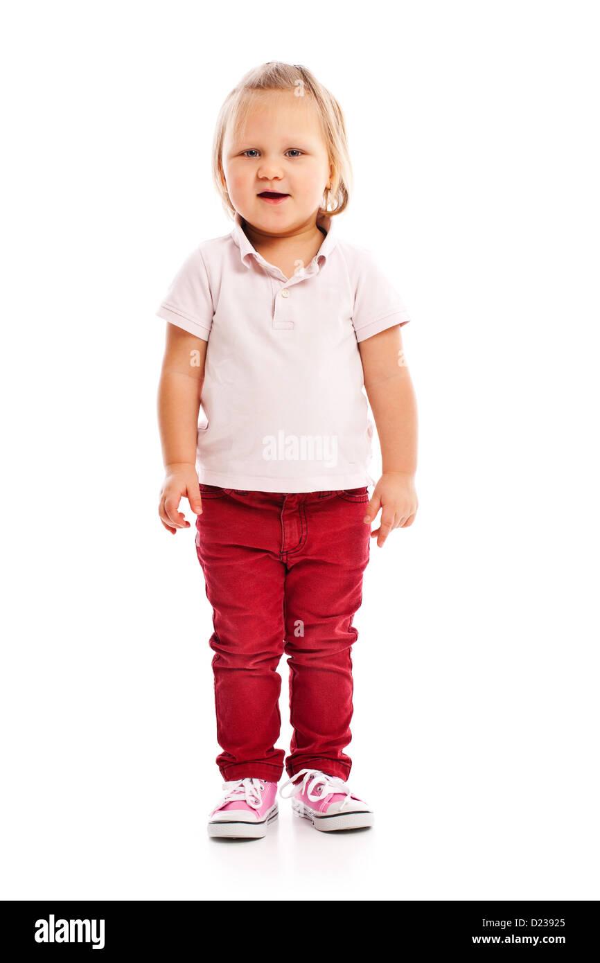 El poco feliz niño posando en el studio Imagen De Stock