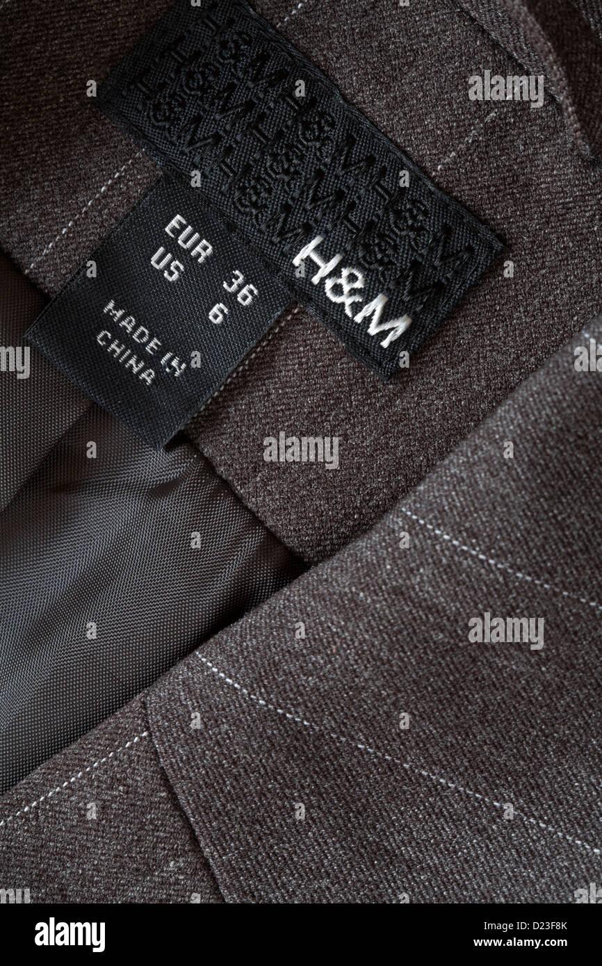 Fabricado en China etiqueta en H M chaqueta marrón rayas pin - vendido en  el Reino Unido 47678ff413f