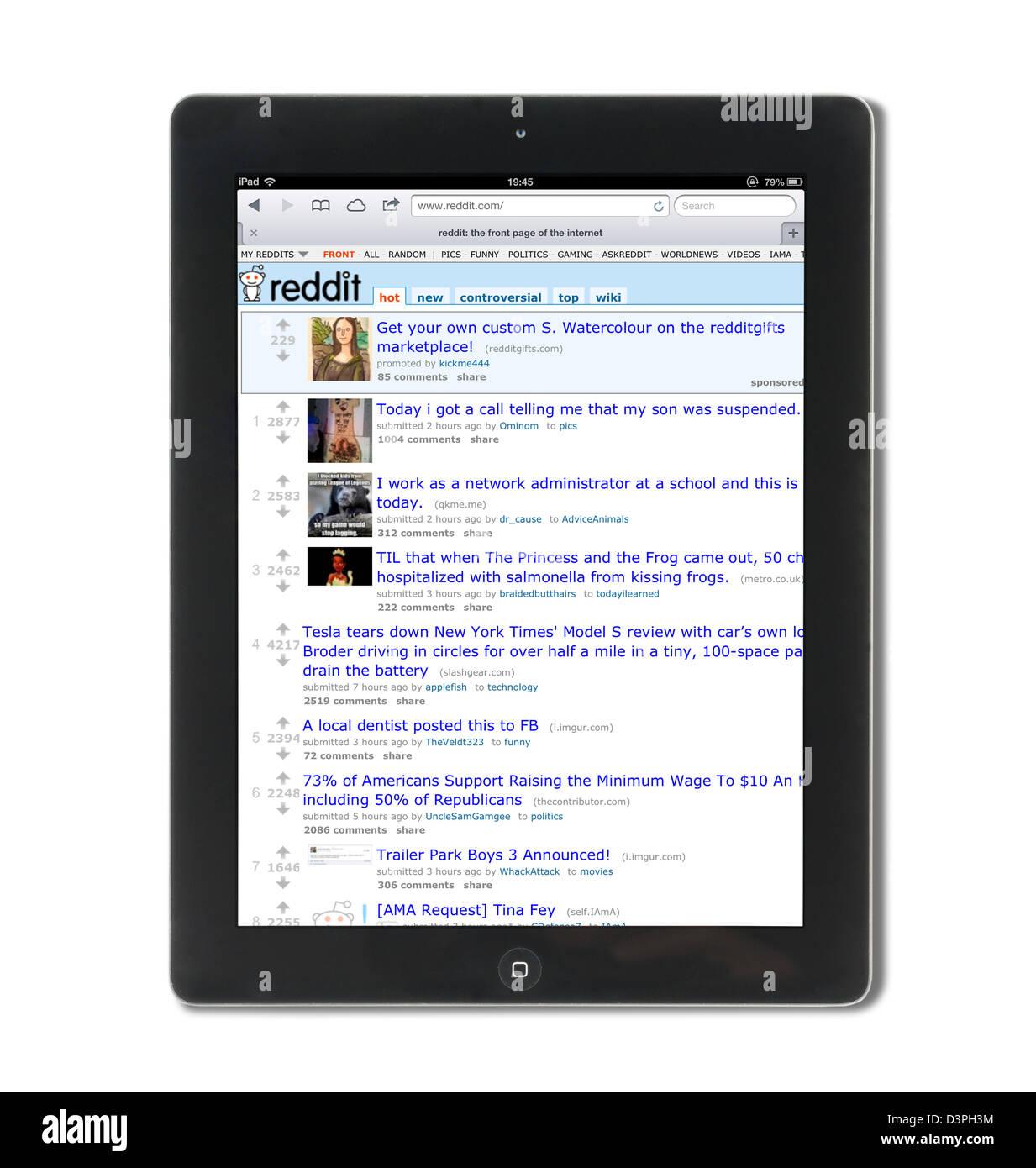 Reddit, el sitio de noticias y entretenimiento, sociales, vistos en una 4ª generación de Apple iPad Imagen De Stock