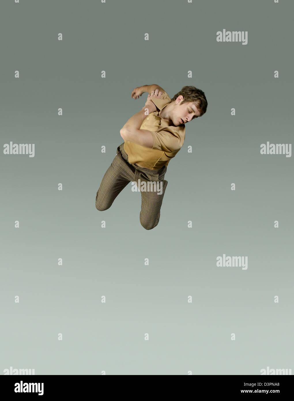 Los seres humanos congelados flotando en el aire. Imagen De Stock