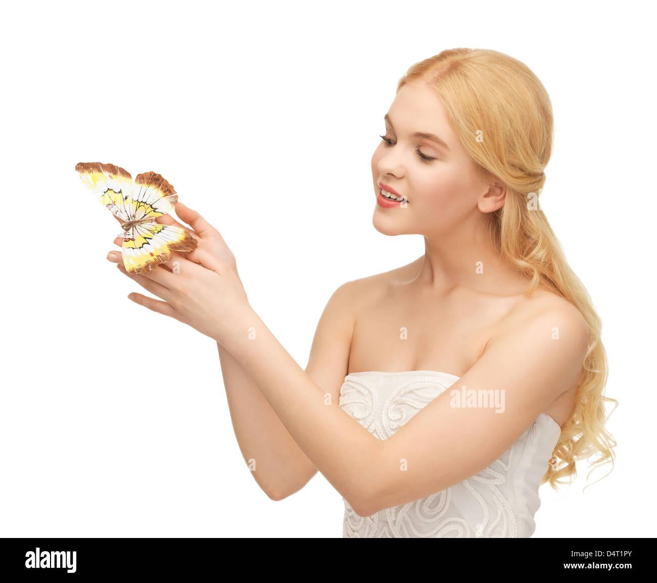 Mujer con mariposas en la mano Foto de stock