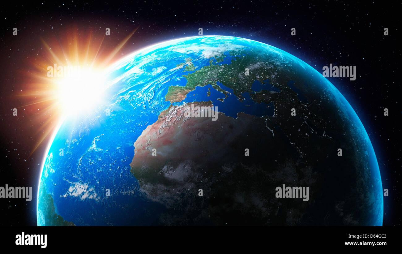 Puesta de sol detrás de la tierra, obra de arte Foto de stock