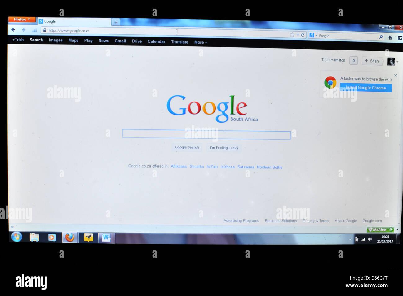 Imagen de la pantalla de una computadora que muestra la página de inicio de Google de Sudáfrica. Imagen De Stock