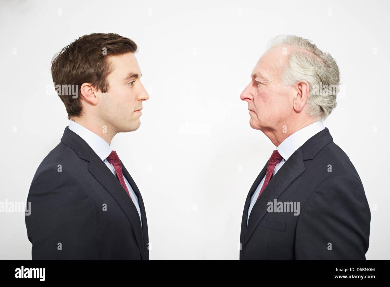 Los empresarios, uno frente a otro Imagen De Stock