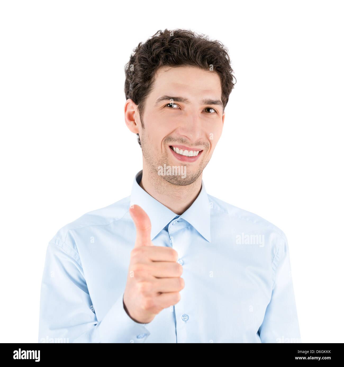 Close-up retrato de un exitoso empresario guapo que sonríe y muestra un gesto hacia arriba con el pulgar a Imagen De Stock