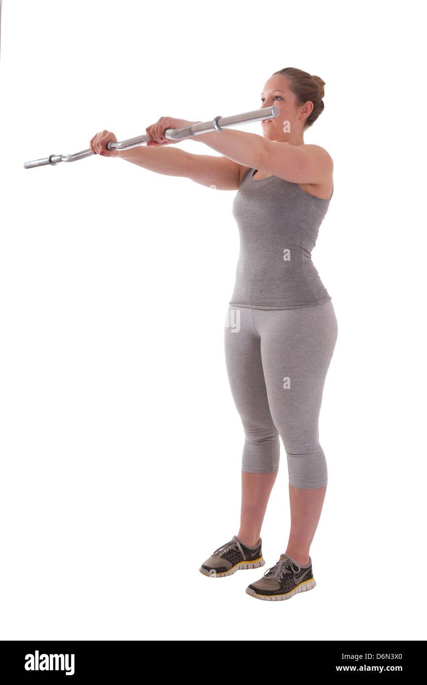 El ejercicio y la salud femenina sobre fondo blanco. Imagen De Stock