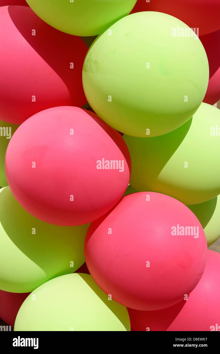 Globos de color verde y rosa Imagen De Stock