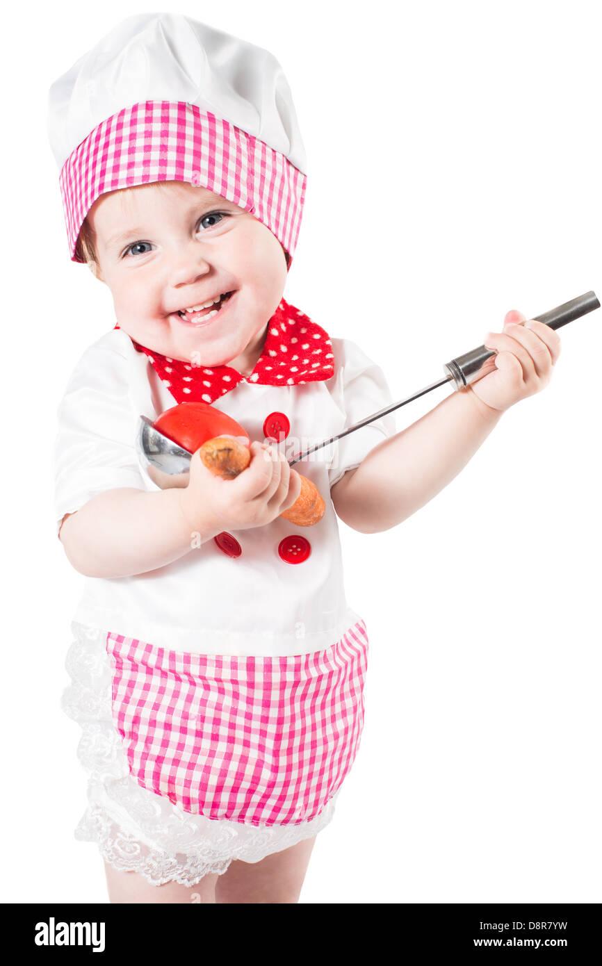 Baby Girl vistiendo un sombrero de chef con verduras y pan aislado sobre  fondo blanco.El concepto de comida saludable y la infancia 766411645958