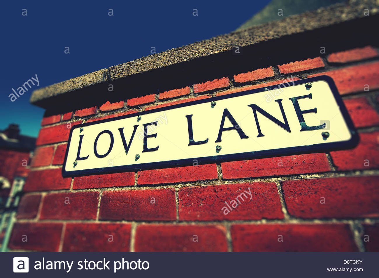 Love Lane firmar en la paredFoto de stock