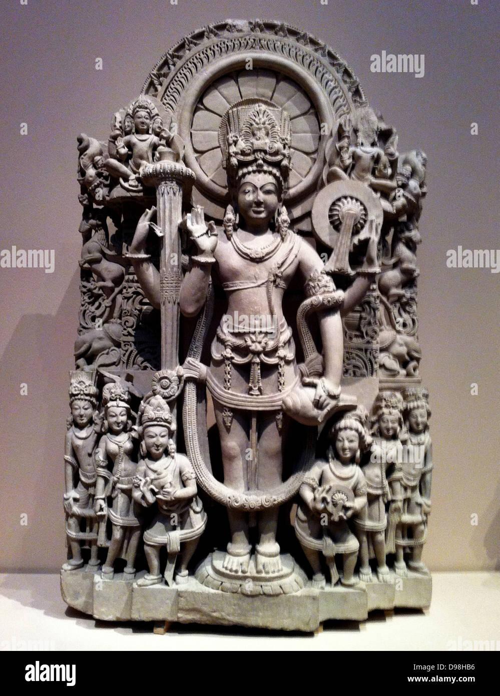 Estela de cuatro soldados armados de Vishnu. La India, 10º-11º siglo DC. Arenisca Imagen De Stock
