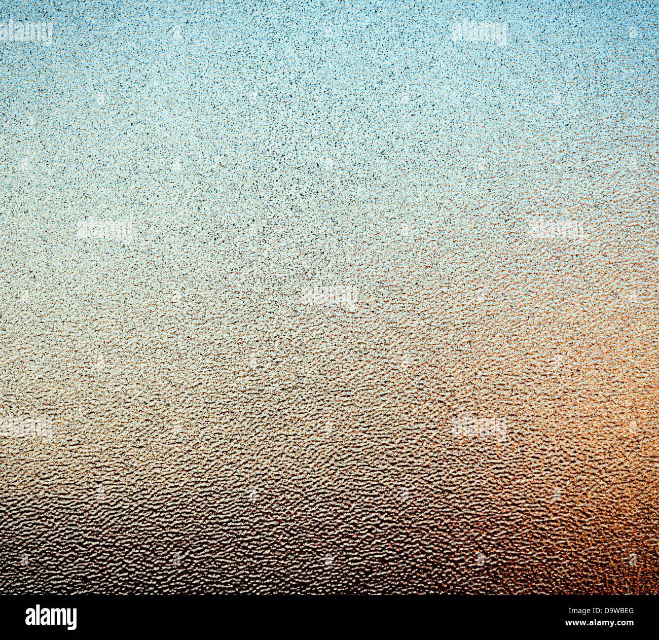 Resumen del panel de cristal punteada con colores ambientales desde afuera como textura de fondo Imagen De Stock