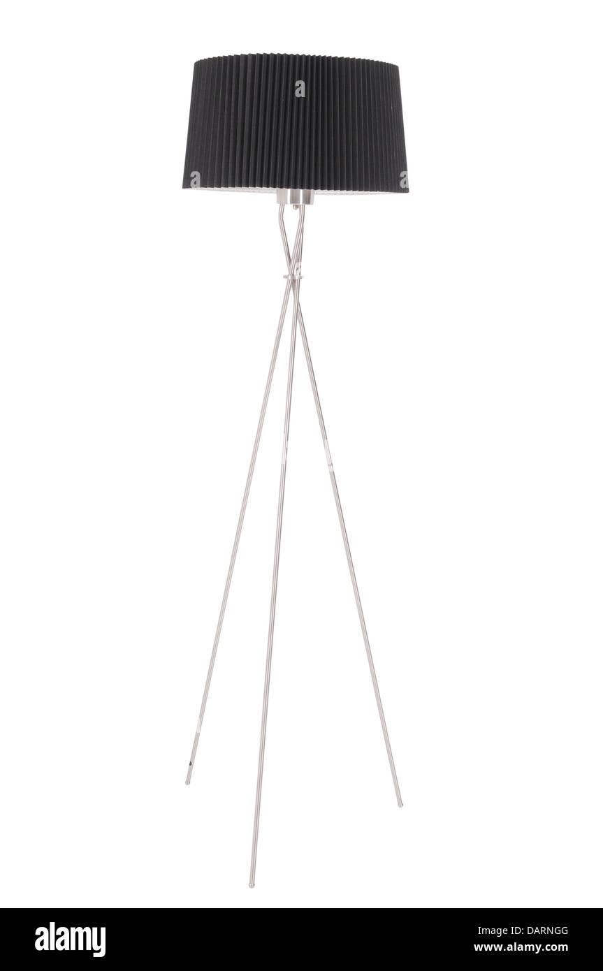 Lámpara de piso con una sombra negra sobre un fondo blanco. Imagen De Stock