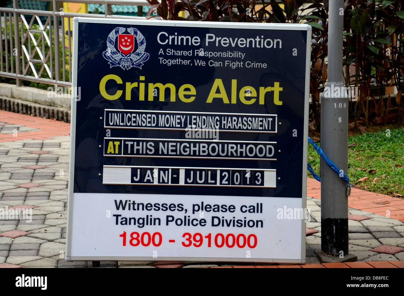La policía de Singapur tiburón de préstamo el préstamo de dinero acoso aviso de alerta Foto de stock