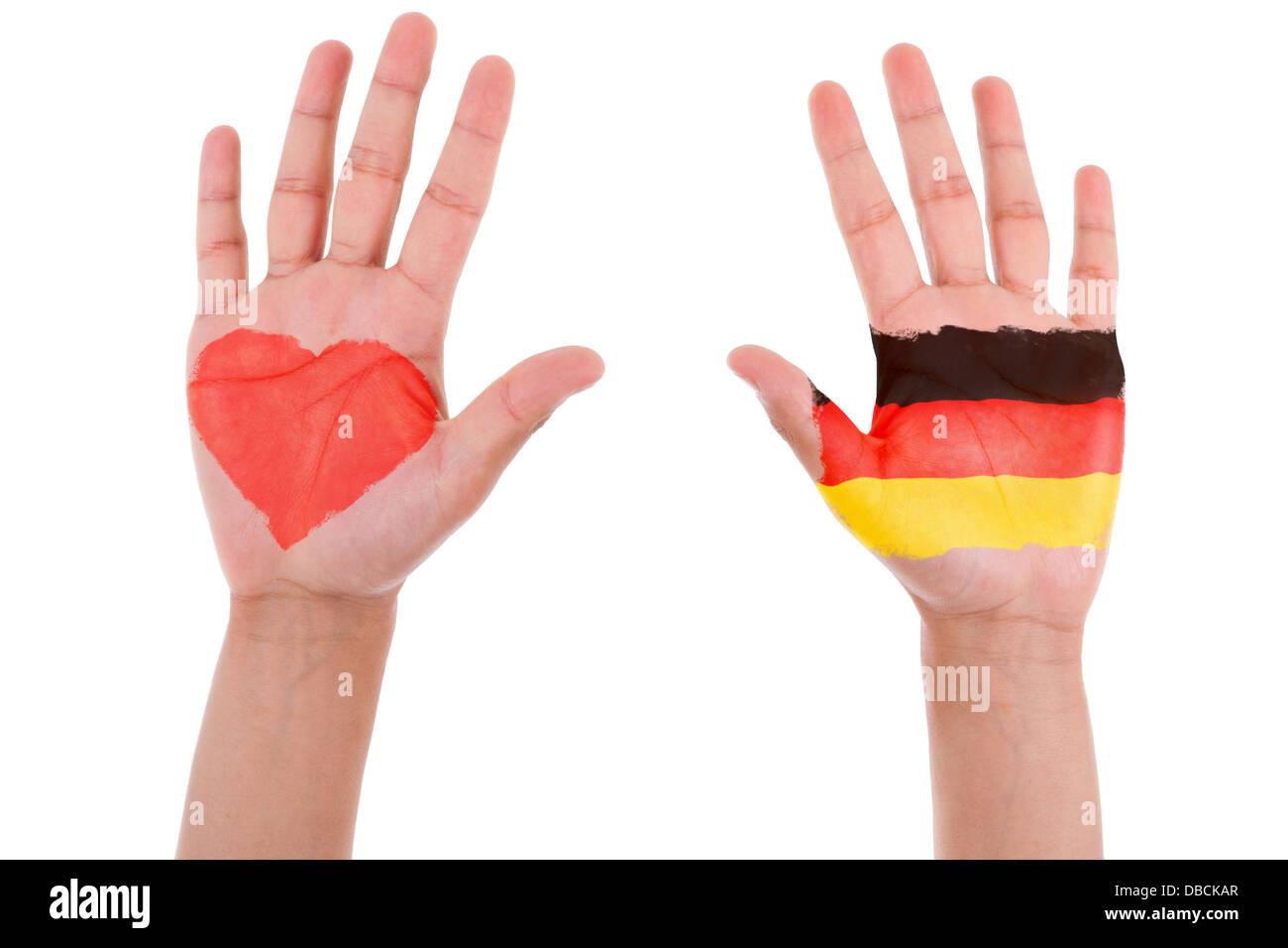 Manos pintadas con un corazón y la bandera alemana, me encanta Alemania concepto, aislado sobre fondo blanco. Foto de stock