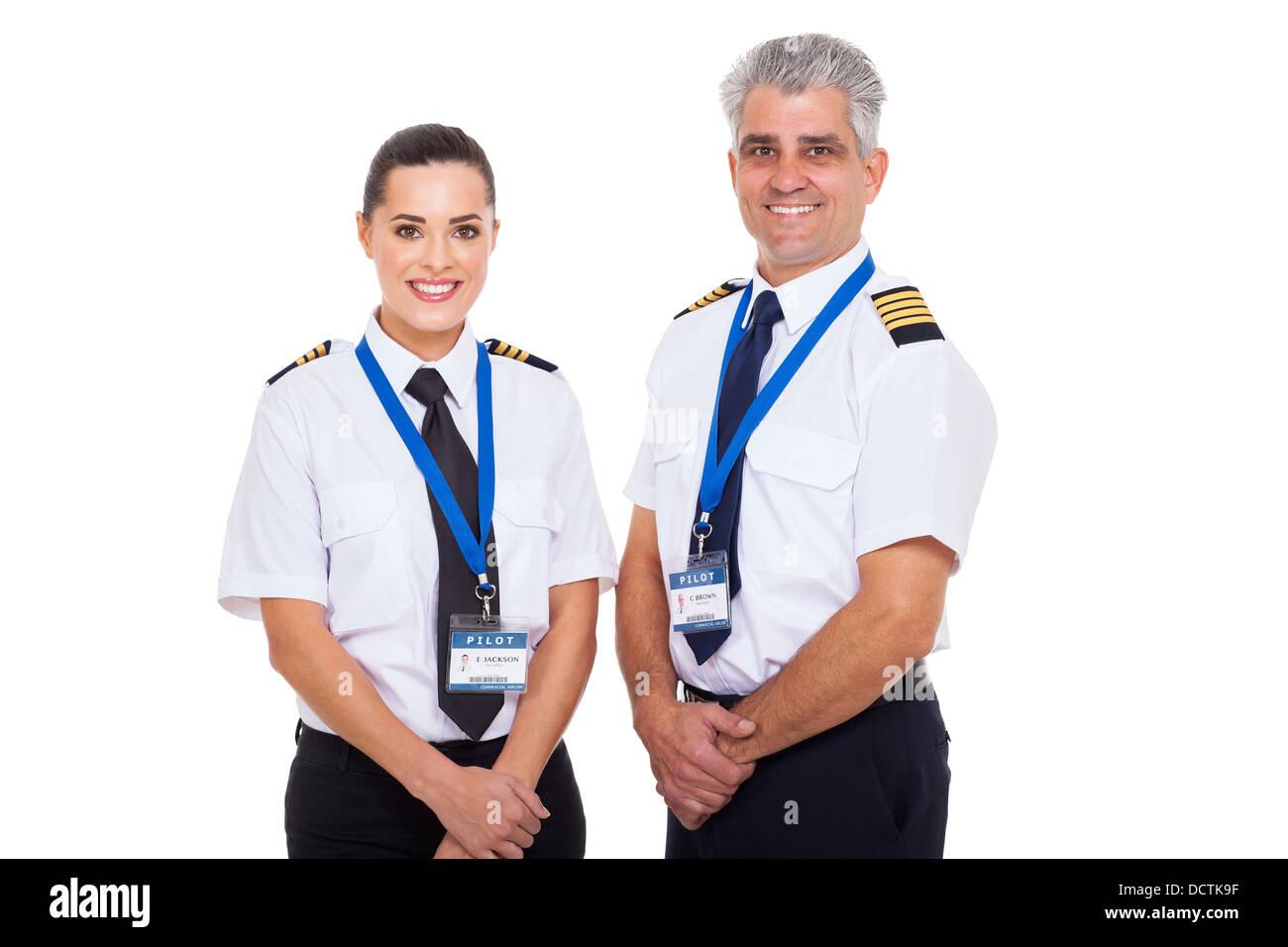 Aerolínea comercial profesional capitán y primer oficial retrato sobre fondo blanco. Imagen De Stock