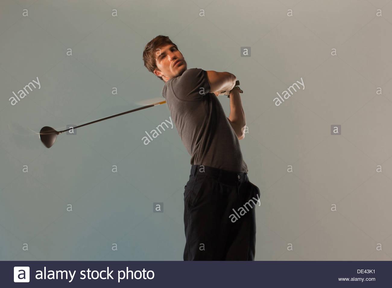 Vista borrosa de jugador de golf club oscilante Imagen De Stock