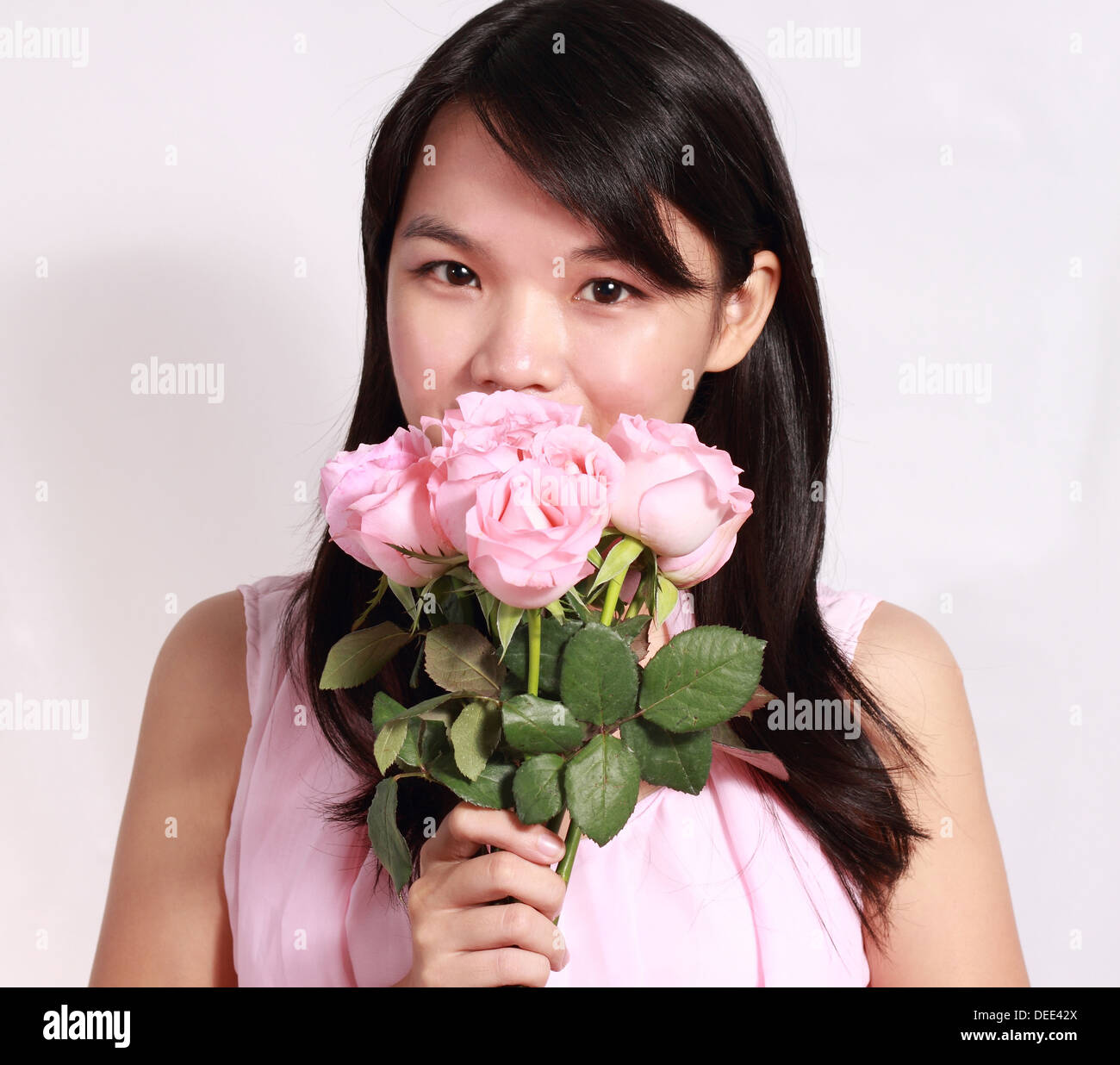 Asian Chinese Girl Holding Flower Imágenes De Stock & Asian Chinese ...
