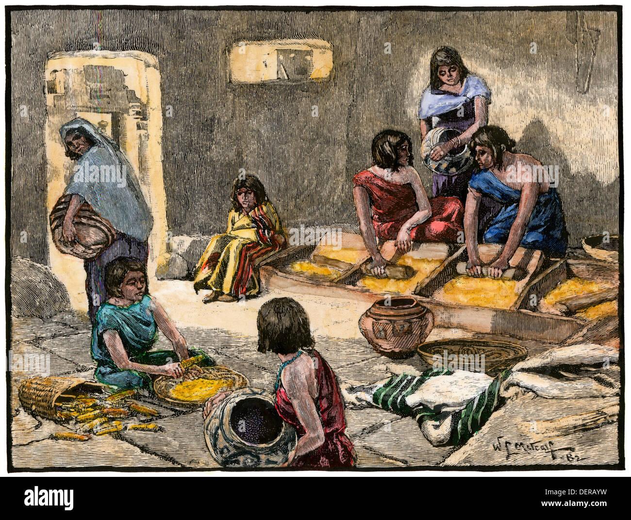 Las mujeres pueblo zuni la molienda del maíz, 1800. Xilografía coloreada a mano Imagen De Stock