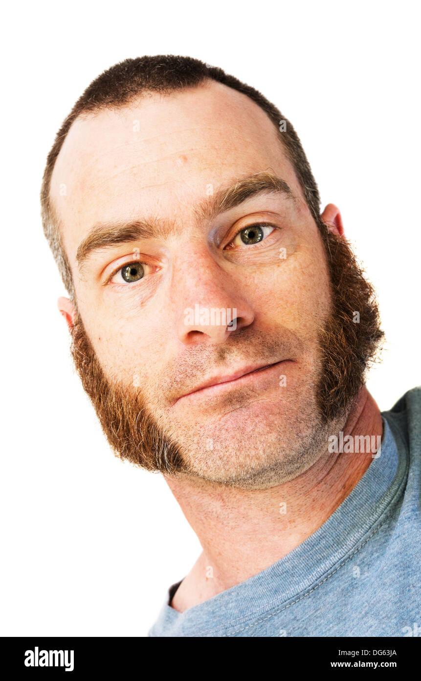 Hombre con chuletas de cordero, las patillas y el pelo corto Imagen De Stock