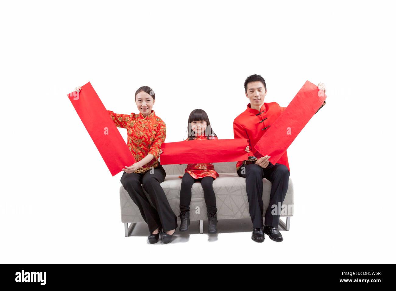 Familia de tres vestidos de traje Imagen De Stock