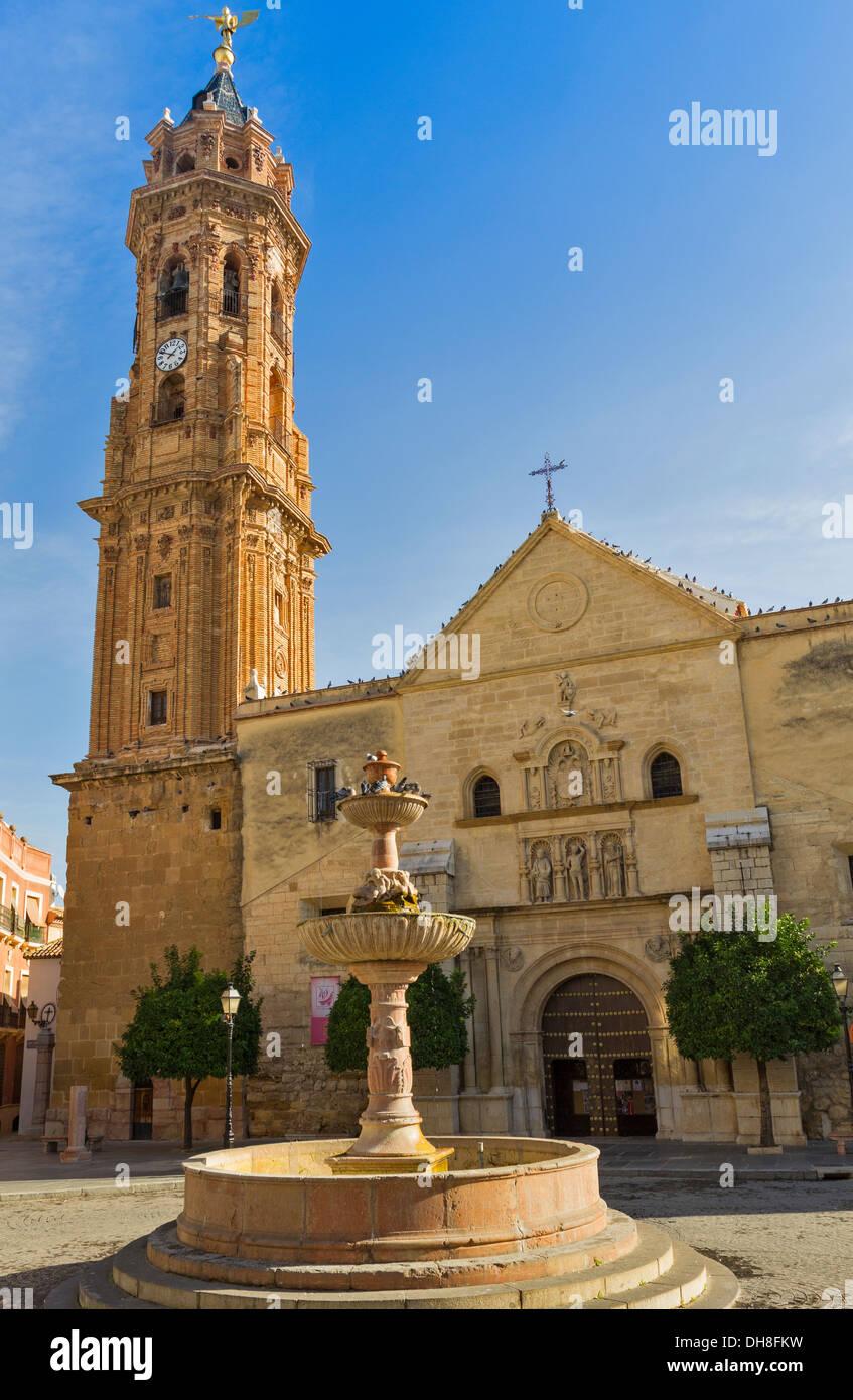 ANTEQUERA SPAIN la iglesia colegial de San Sebastián en la plaza de San Sebastián con fuente y palomas Imagen De Stock