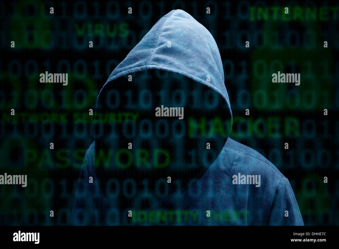 Encapuchados, silueta de un hacker Imagen De Stock