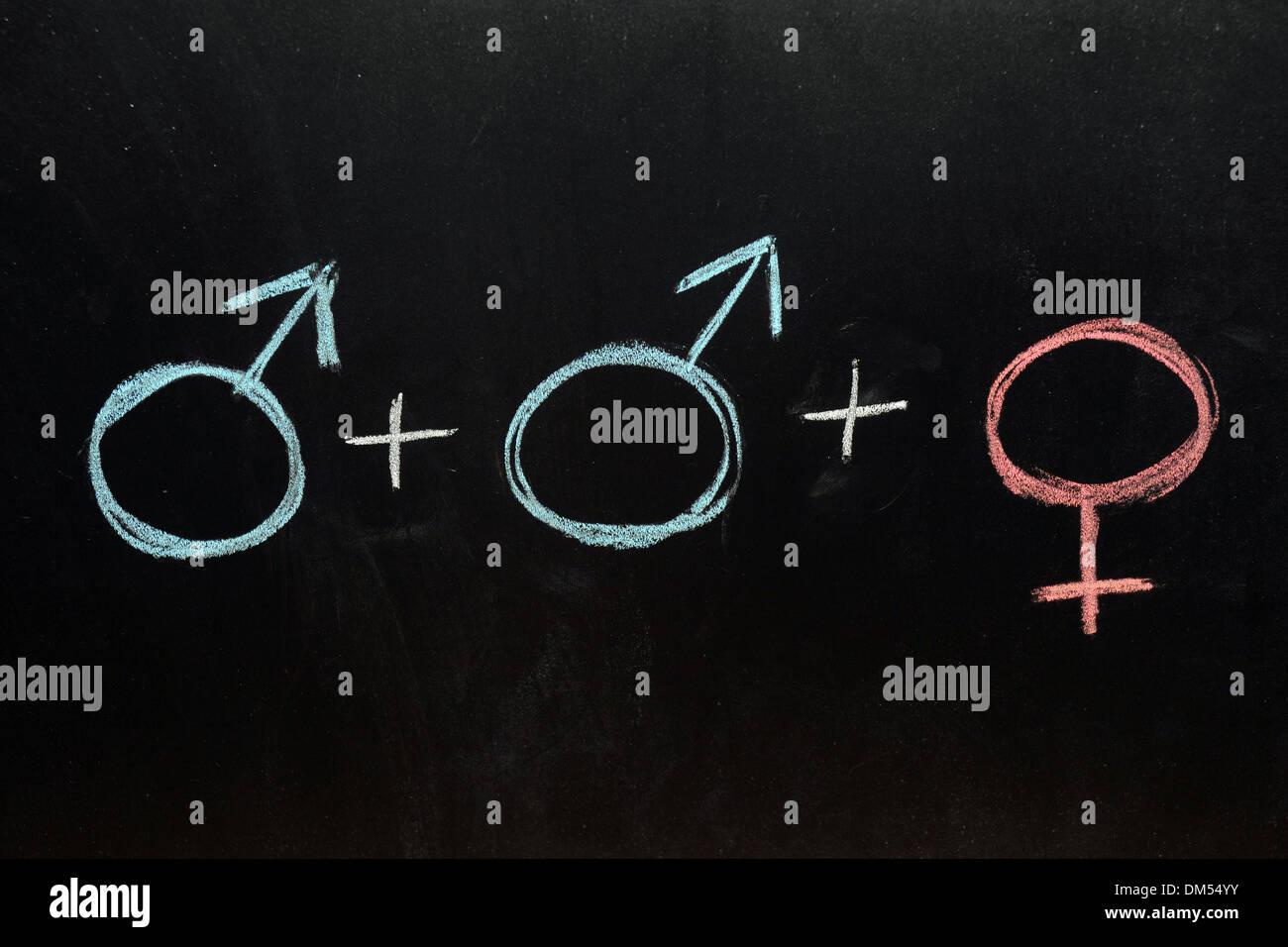 2 macho y 1 hembra símbolos de género dibujado en una pizarra de tiza. Imagen De Stock