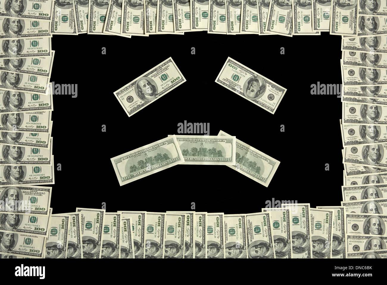 Cara triste en Dollar Bill frame Imagen De Stock