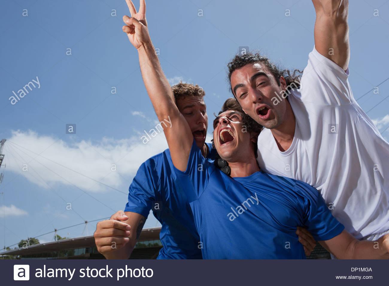 Jugadores de fútbol vítores Imagen De Stock