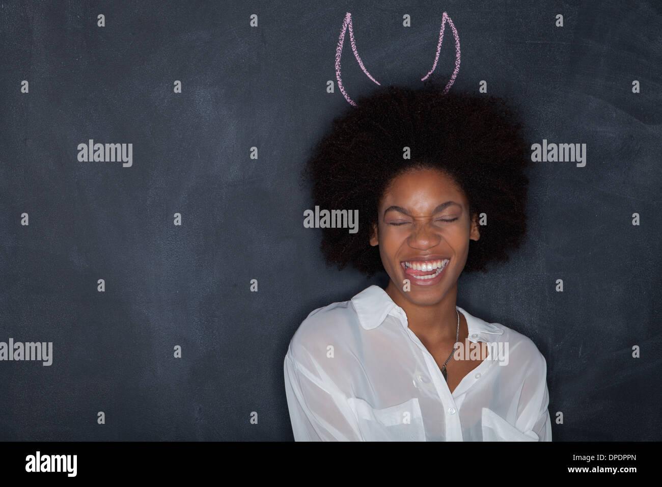 Mujer joven con cuernos por Blackboard Imagen De Stock